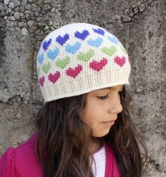 Skill Level: IntermediateA timeless beanie to show your love.Using the Fair Isle technique this beanie will fit all ages and can be made in all colors. The ones pictured are just a touch of the combinations you can create.Fair Isle is a technique where two colors are used in any particular row to create pictures or designs in your project. Don't know how to do Fair Isle