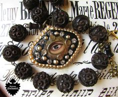 Madonna Enchanted necklace mourning lovers eye Victorian carved rosary beads one of a kind faux pearl evil eye jewelry assemblage all seeing by madonnaenchanted on Etsy