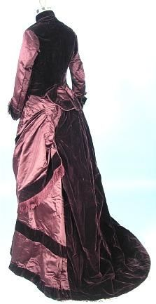 This is an eggplant colored bustle gown in almost perfect condition from someone's attic. So incredibly gorgeous! Amazing its survived this long.