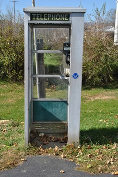 Semi enclosed telephone booth...mid 70's and beyond