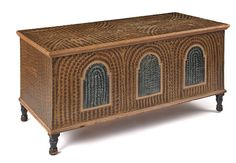 Sold $3,800 Lebanon County, Pennsylvania painted poplar blanket chest, ca. 1830, retaining its original brown and ochre sponge decoration with three blu...