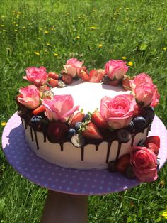 Birthday cake with roses and fruits