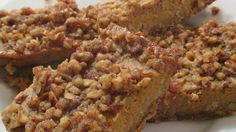 These hand-held pumpkin custard treats have an oatmeal crust and a nut and brown sugar topping.