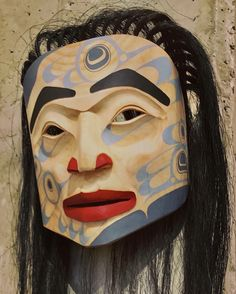 An exceptional knife-carved mask, delicately painted with hummingbird design. Frog Mask, John Wilson, Indigenous Art, Horse Hair, Hummingbird, Art Gallery, Halloween Face Makeup, Carving, Horses