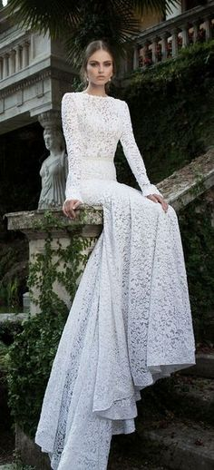 love the long sleeves and lace, can imagine this with a low back  - seems like a good dress for a winter/autumn wedding
