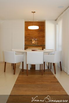 Dining room with wood corridor by Viviane Dinamarco