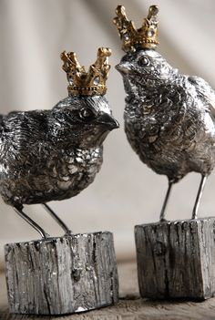 """5"""" Crowned Birds on Blocks $24    hand-crafted one bird is 5"""" tall, the other is 5.75"""" tall  both are 5"""" long  weighted metal  gold crowns with rhinestones on both  set of two birds."""