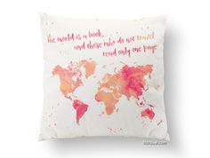 Travel lover gift idea. Watercolor style world map silhouette and inspirational quote, printed in a soft pillow case.   Color combination: sunset orange, pink and yellow in a off-white background (a very light cream color)  Quote: The world is a book and those who do not travel read only one page.