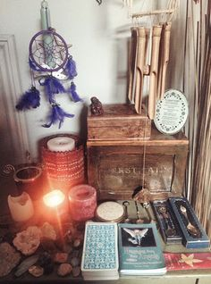 Dream catchers. Crystals. Wind chime. Candle