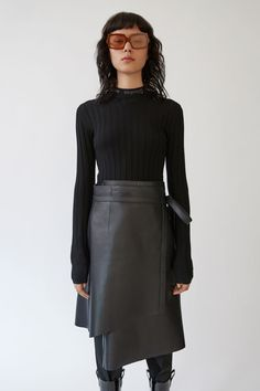 Acne Studios Carina Merino black is a body conscious ribbed crewneck pullover sweater.
