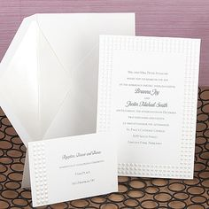 A string of shimmering, embossed pearl beads wraps luxuriously around your wording on this bright white card. The embossed design is both contemporary and elegant, making this invitation the perfect prelude to your wedding day.