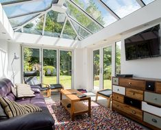 A conservatory can make a great TV lounge. So invite friends round, sit back and watch a film – it's just like being at the cinema! Upvc Windows, Windows And Doors, Conservatory Decor, Cinema Room, Home Cinemas, Interior Inspiration, Ideal Home, Home Improvement, New Homes