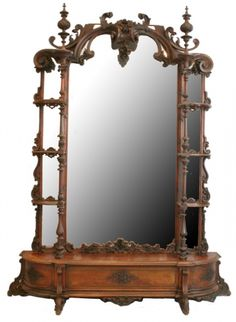 Carved Rosewood Etegere Featuring Bold Rococo Floral Carvings, Large Floral Hanging Finial, Shell Carved Decoration At Base Of Mirror - Attributed To Alexander Roux - New York   c.1855