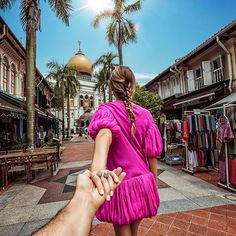 Murad Osmann and Nataly Osmann: Follow me to Kampong Glam in Singapore. Took this photo right in front of the Sultan Mosque.
