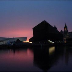 Liverpool Albert Dock / Liver Buildings with stunning sunset.