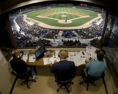 Press box view of Vin Scully calling a sold out game at Camelback Ranch in Glendale, Arizona