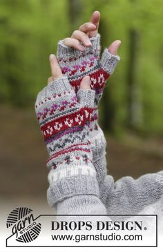 The set consists of: Knitted jumper with round yoke, multi-coloured Norwegian pattern and A-shape, worked top down. Wrist warmers with multi-coloured Norwegian pattern. Knitting Patterns Free, Free Knitting, Free Pattern, Wrist Warmers, Hand Warmers, Knitted Gloves, Fingerless Gloves, Jumper, Drops Design