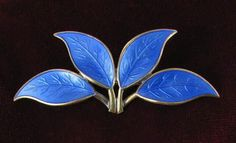 David Andersen basse taille leaf pin in sterling silver - http://collectingvintagejewelry.blogspot.com/2013/03/designer-of-week-david-andersen.html