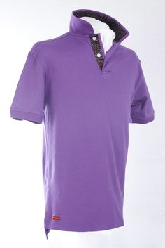 Our classic-fitting short-sleeved polo in breathable cotton interlock, finished with captivating Robert Owen Collection signature flag.  Color: Purple  Collar: (Black and Pink Dots Satin Print)   Two-button concealed twill placket, contrasting twill collar. Collar topside has fashionable print similarities of placket. Our signature Robert Owen Collection flag label, accents the lower right. Accompanied by matching handkerchief. 100% cotton. Machine washable. Imported.  $70.00