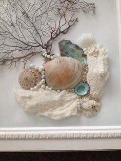This beautiful white shadow box is a collage with Black Sea fan, coral and sea shells. This is a one of a kind art that would enhance any wall decor but especially beach or cottage style. Please contact me for custom orders in different sizes, colors and designs. The size of this shadow box is 15 square.