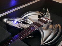 "Today we want to show you something really creative - custom guitar in the form of dragon. This chrome metallic dragon ""Draco"" guitar was created by Emerald Guitars"