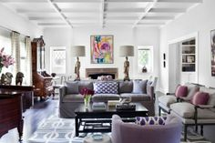 In this photo provided by Burnham Design, shades of purple and lavender are mixed with softer shades of gray and black accents in a living room designed by Betsy Burnham of Burnham Design. Photo: Sarah Dorio, AP / Burnham Design