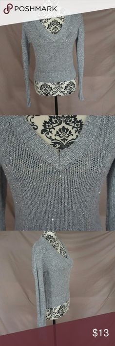 Sparkly Silver Metallic Crop Sweater This sweater is a Size Large by Mudd. In used condition. No snags or holes. The size tag was removed because it was scratchy but it IS a size Large. Silver with metallic thread and sequins throughout. V-Neck style pullover. Mudd Sweaters Crew & Scoop Necks