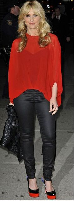 Sarah Michelle Gellar in NYC on 2/6/12 wearing DL1961 black jeans and Christian Louboutin shoes.