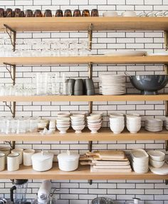 my future kitchen shelves...who needs cabinets? Ali Cayne's NYC townhouse home Greenwich Village