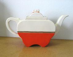1930s Art Deco Teapot. Fraunfelter China Zanesville Ohio. Orange and platinum on ivory. Apple shape, unique sliding lid.