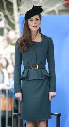 Kate Middleton. In this outfit case I think wearing a boot that is extra long, right on the knee cap, makes this beautiful, clean illusion of a longer leg. Would love to see that with this outfit.