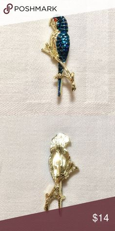 Vintage Blue Parrot Brooch Vintage blue parrot brooch is gold toned with blue enamel and has a ruby rhinestone eye. A little wear. Jewelry Brooches