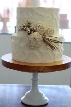 This is my absolute FAVORITE wedding cake. It'd be a good top piece with a bunch of cupcakes underneath - MB