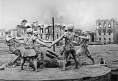 Shot made by Russian photographers during WWII. It was made in the ruins of Stalingrad city – the place where the most heavy city battles took place. The monument itself depicts Russian children dancing around a crocodile, looking so unreal with the traces of bullets on the sculptures and the burning ruins on the background.  Later, after the war the monument was rebuilt, even earlier than surrounding buildings.