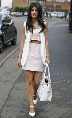 The cold shoulder: Jasmin Walia opted to remove her rather striking powder pink coat as sh...