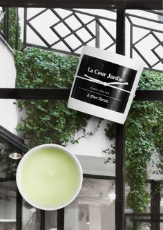 & Other Stories | Scented Candle - 'La Cour Jardin'. Our intoxicating store garden on rue Saint-Honoré is full of white floral secrets. French 'La Cour Jardin' is named after the inner courtyard in the Paris store, home to one of our favourite elements – a flower garden.