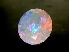 pyritized:  Australian Black OpalWhenever I have the chance I try to find australian Black Opals that are big enough to be faceted. Most of ...