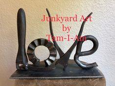 Junkyard Art by Tam-I-Am.  Repurposed scrap metal art.  All you need is love.