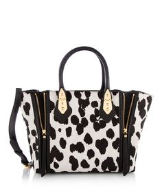 Front row fashionistas will flock to our A List Haircalf Satchel, a designer handbag that no Bendel Girl should be without. Featuring a removable, adjustable crossbody strap for versatile carrying, this must-have luxury handbag is crafted with blocked haircalf panels trimmed with cowhide leather for maximum on-trend appeal.