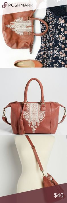 Faux Leather Deep Rose Satchel with Design Deep Rose Color  faux leather patterned graphic front faux leather tassel braided carry handles removable and adjustable crossbody strap one exterior zipper pocket on back one main compartment with zipper closure two interior slip pockets and one interior zipper pocket 11 inches high, 16 inches wide at top, 6 inches deep Bags Satchels