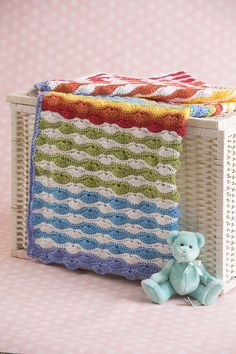 Scrappy Shells Baby - This vibrant and colorful baby blanket makes a great gift. Plan out your colors or use scrap yarn to create a unique variation. From the February 2015 issue of I Like Crochet