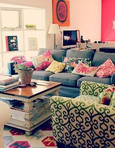 DENIM COUCH, chunky coffee table, desk in the corner, very bright, color blocked walls, pillows everywhere, patterned armchair, a tad bit cluttered but perfectly preppy, THERE AREN'T WORDS. there are just no words.