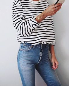 Black striped t-shirt, skinny jeans, gold bracelets