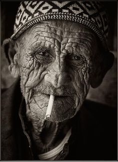 Israel, man, male, guy, oldie, aged, cigarette, smoking, wrinckled, aged, charming, face, intense, a face that have stories to tell, have lived a lifetime, portrait, photograph, photo b/w.