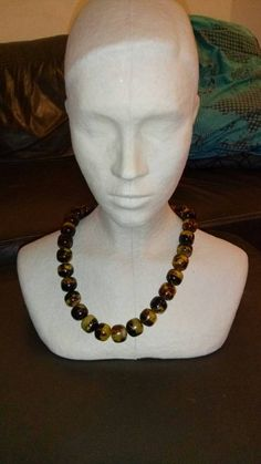 Check out this item in my Etsy shop https://www.etsy.com/it/listing/252031805/necklace-tortoise-turtle-shell-beads