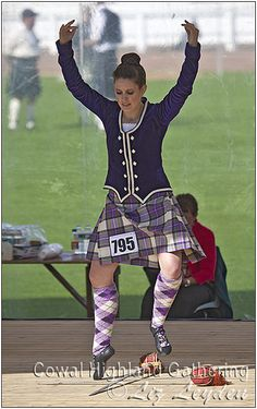 Dress Heather Stewart Kilt with purple jacket Mikhaila Markham at Cowal. Purple Jacket, Purple Dress, Scottish Highland Dance, Stewart Tartan, Drum Major, Highland Games, Irish Dance, Dance Photos, Plaid Skirts