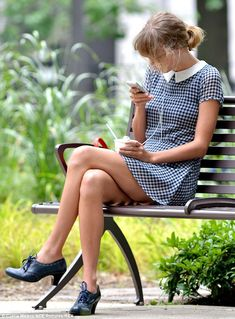 Me, myself and I: Taylor listened to her iPod and appeared to be deep in thought as she spent some solo time in the park