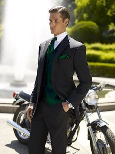 Stylish groomsmen's ensemble in dark green with a gray suit.