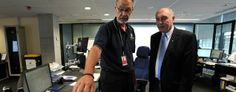 Australian Deputy Prime Minister Warren Truss, right, and John Rice, senior search-and-rescue officer at rescue coordination center of the Australian Maritime Safety Authority in Canberra (Graham Tidy/Pool/AP)