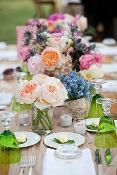 Love all the flowers on this table and the green glasses